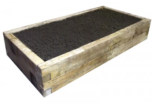 Oblong oak raised bed with soil